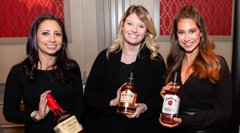 Girls with whiskey bottles at whiskey revival